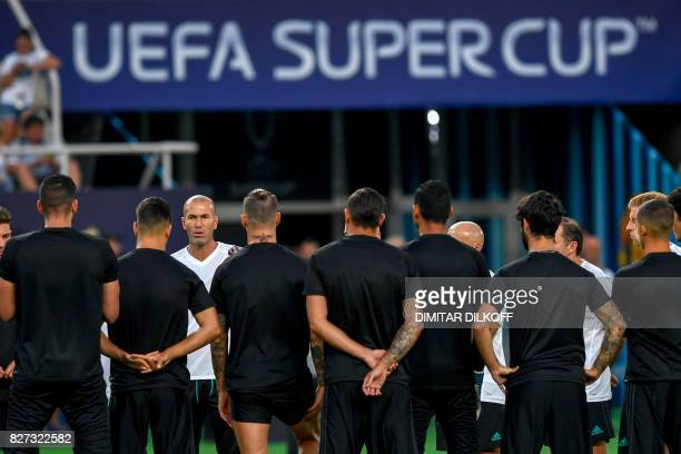 French Real Madrid coach Zinedine Zidane talks to his players during training session ahead of the UEFA Super Cup 2017 football match between Real...