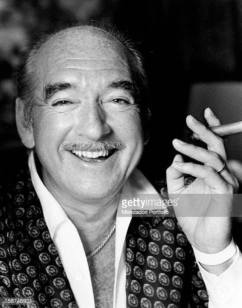 French recordcompany owner Eddie Barclay smoking a cigar and smiling Paris 1970s