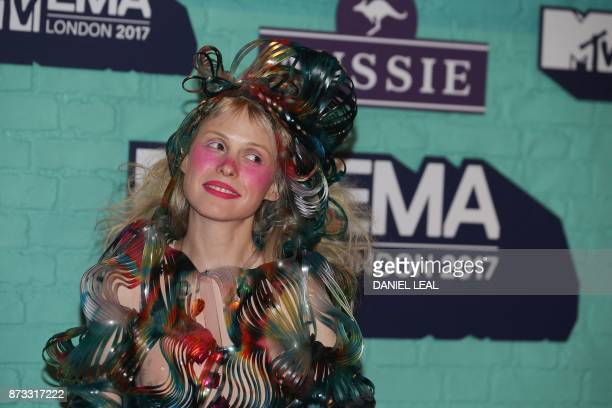 French recording artist Petite Meller poses on the red carpet arriving to attend the 2017 MTV Europe Music Awards at Wembley Arena in London on...
