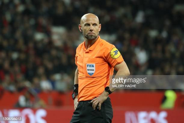 French refeere Amaury Delerue looks on during the French L1 football match Nice against Monaco on March 7 at the Allianz Riviera stadium in Nice...