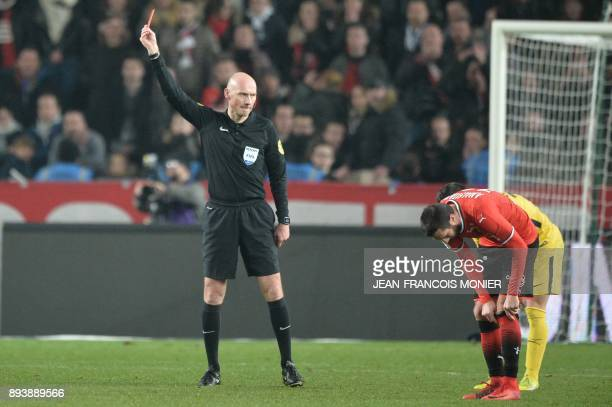 French refere Anthony Gautier gives a red card to Rennes' French midfielder Benjamin Andre during the French L1 football match between Rennes and...