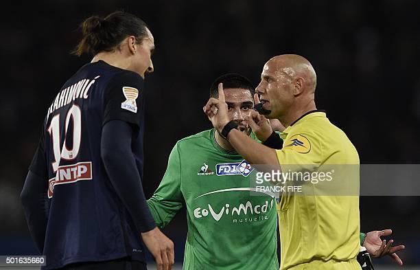French referee Amaury Delarue gestures next to SaintEtienne's French forward Neal Maupay and Paris SaintGermain's Swedish forward Zlatan Ibrahimovic...
