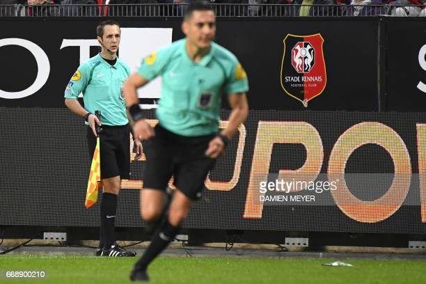 French referee Benjamin Pages looks on during the French L1 football match Rennes against Lille on April 15 2017 at the Roazhon park stadium in...