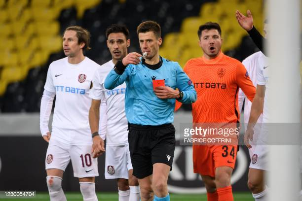 French referee Benoit Bastien sends off CFR Cluj's Romanian goalkeeper Cristian Balgradean during the UEFA Europa League Group A football match...