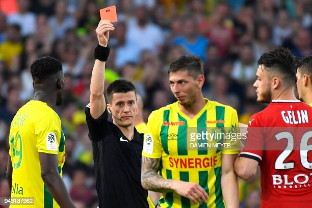 French referee Benoit Bastien shows a red card to Nantes' Argentinian forward Emiliano Sala during the French L1 football match Nantes against Rennes...