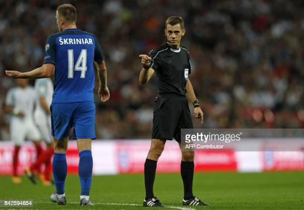 French referee Clement Turpin gestures during the World Cup 2018 qualification football match between England and Slovakia at Wembley Stadium in...