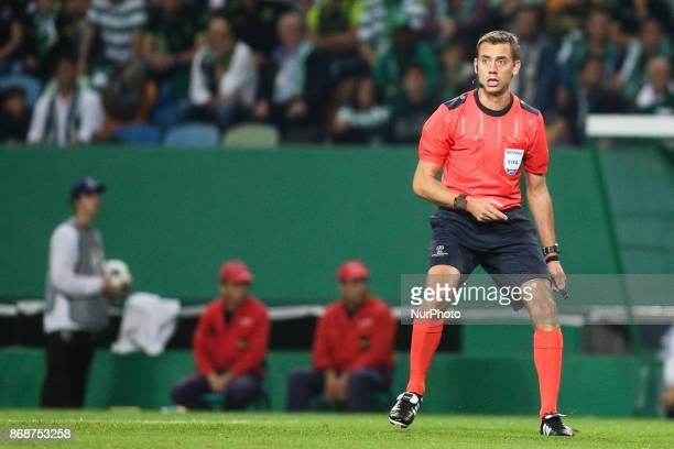French referee Clement Turpin in action during the Champions League football match between Sporting CP and Juventus FC at Jose Alvalade Stadium in...