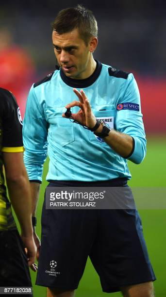 French referee Clement Turpin reacts during the UEFA Champions League Group H football match BVB Borussia Dortmund v Tottenham Hotspur at the BVB...