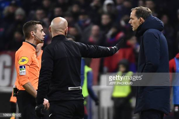 French referee Clement Turpin talks to Paris SaintGermain's German coach Thomas Tuchel on the side of the pitch during the French L1 football match...