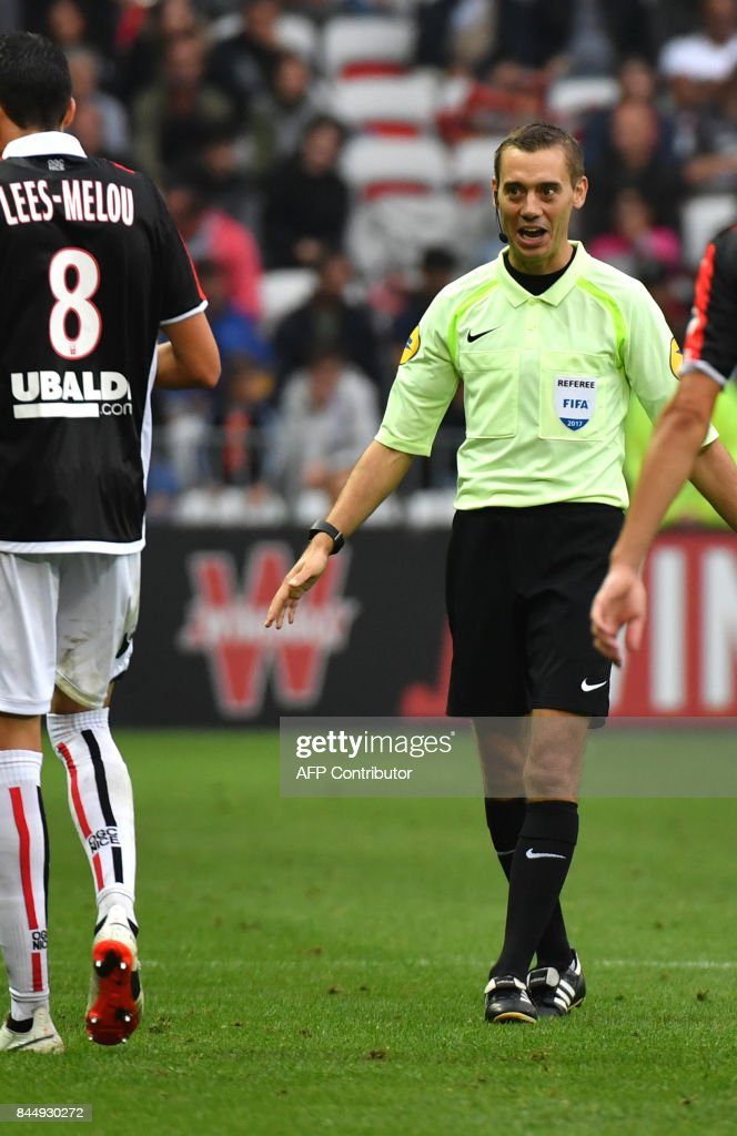 French referee Clément Turpin reacts during the French L1 football match Nice (OGCN) vs Monaco (ASM) on September 9, 2017 at the 'Allianz Riviera' stadium in Nice, southeastern France. /