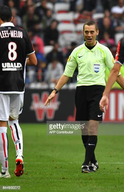 French referee Clément Turpin reacts during the French L1 football match Nice vs Monaco on September 9 2017 at the 'Allianz Riviera' stadium in Nice...