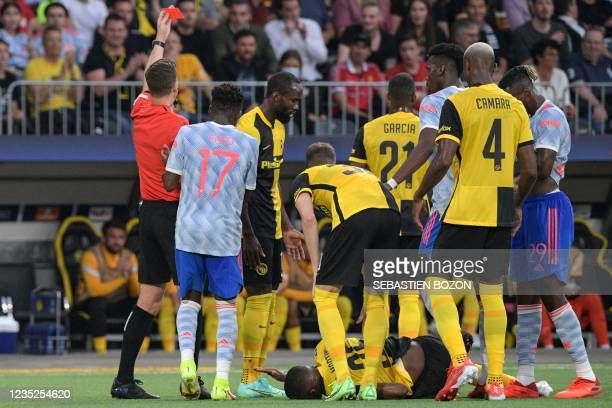 French referee Francois Letexier shows a red card to Manchester United's English defender Aaron Wan-Bissaka following a tackle on Young Boys'...