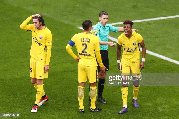French referee Francois Letexier talks to Paris Saint-Germain's French defender Presnel Kimpembe as Paris Saint-Germain's French midfielder Adrien...