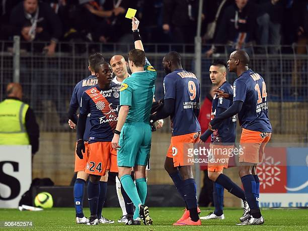 French referee François Letexier gives a yellow card to Montpellier's French forward Jerome Roussillon during the French L1 football match between...