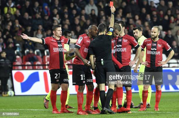 French referee Jerome Brisard gives a red card to Guingamp's French midfielder Lucas Deaux during the French L1 football match between Guingamp and...