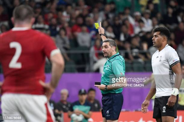 French referee Jerome Garces holds yellow card during the Japan 2019 Rugby World Cup Pool D match between Wales and Fiji at the Oita Stadium in Oita...