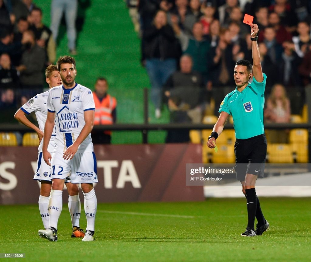 French referee Karim Abed (R) gives a red card to Troyes' French defender Mathieu Deplagne (L) during the French L1 football match between Metz (FCM) and Troyes (ESTAC) on September 23, 2017 at the Saint-Symphorien stadium in Longeville-les-Metz, northeastern France. VERHAEGEN