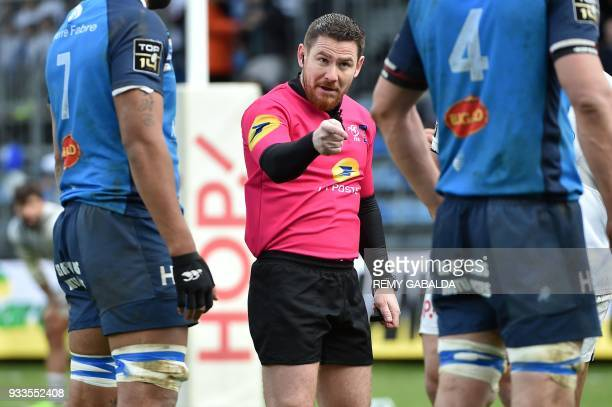 French referee Laurent Cardona gestures during the French Top 14 rugby union match between Castres and Brive on March 18 at the Pierre Fabre Stadium...