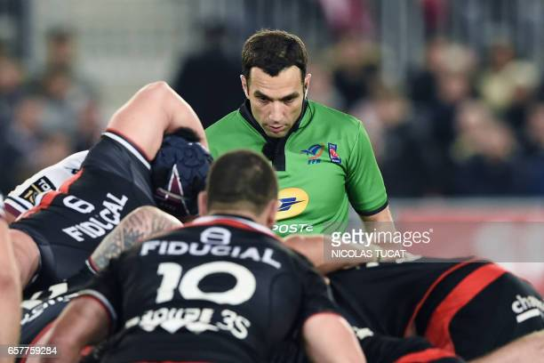 French referee Mathieu Raynal observes the players during g the French Top 14 rugby union match between BordeauxBegles and Toulouse on March 25 2017...