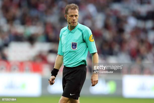 French referee Olivier Thual looks on during the French L1 football match Nice vs Dijon on November 5 2017 at the 'Allianz Riviera' stadium in Nice...