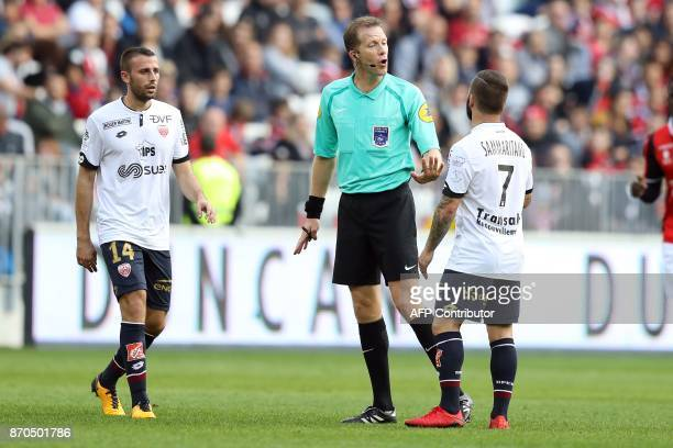 French referee Olivier Thual speaks with a player during the French L1 football match Nice vs Dijon on November 5 2017 at the 'Allianz Riviera'...