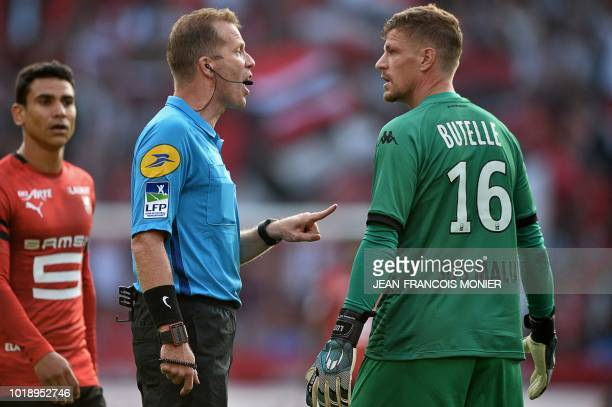 French referee Olivier Thual talks to Angers' French midfielder Pierrick Capelle during the French L1 Football match between Rennes and Angers at the...