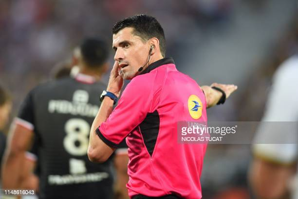 French referee Pascal Gauzere gestures during the French Top 14 semifinal rugby union match between Toulouse and La Rochelle on June 8 2019 at the...