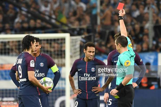 TOPSHOT French referee Ruddy Buquet shows a red card to Paris SaintGermain's Brazilian forward Neymar during the French L1 football match between...