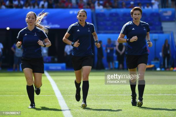 French referee Stephanie Frappart and her assistants Manuela Nicolosi and Michelle O'Neill warm up prior to the France 2019 Womens World Cup football...