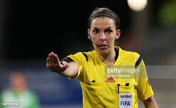 French referee Stephanie Frappart gestures during the first UEFA Women's Champions League quarter final match between VfL Wolfsburg and FC Rosengard...
