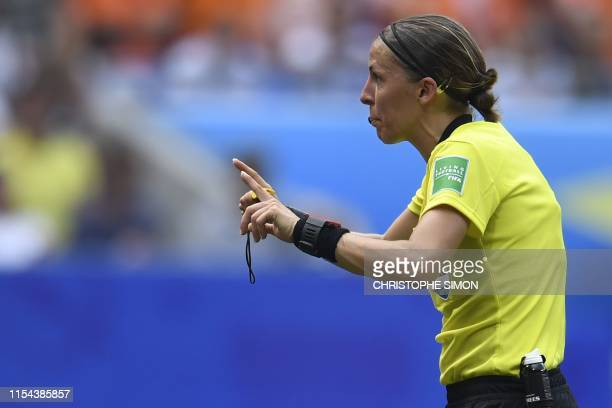 French referee Stephanie Frappart gestures during the France 2019 Womens World Cup football final match between USA and the Netherlands on July 7 at...