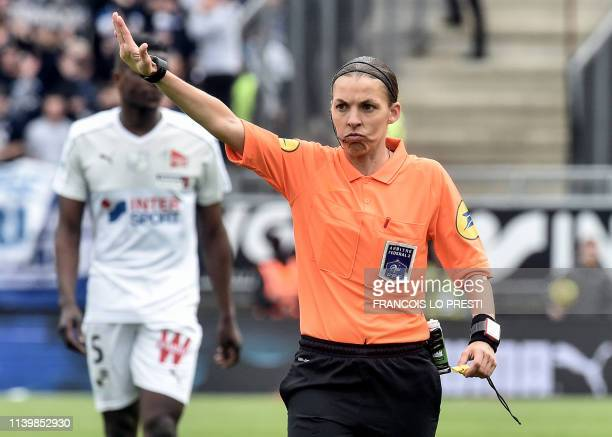 TOPSHOT French referee Stephanie Frappart gestures during the French L1 football match between Amiens SC and Strasbourg on April 28 2019 at the...