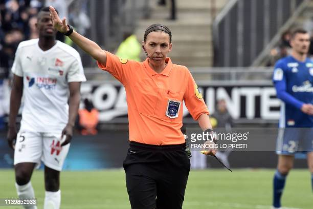 French referee Stephanie Frappart gestures during the French L1 football match between Amiens SC and Strasbourg on April 28 2019 at the Licorne...