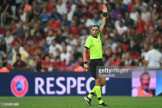 TOPSHOT French referee Stephanie Frappart gestures during the UEFA Super Cup 2019 football match between FC Liverpool and FC Chelsea at Besiktas Park...