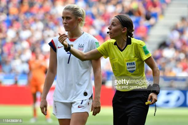 French referee Stephanie Frappart gestures next to United States' defender Abby Dahlkemper during the France 2019 Womens World Cup football final...