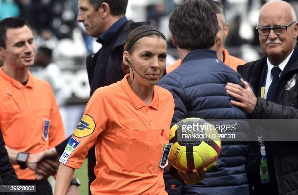 TOPSHOT French referee Stephanie Frappart holds a ball as she leaves the pitch at the end of the French L1 football match between Amiens SC and...