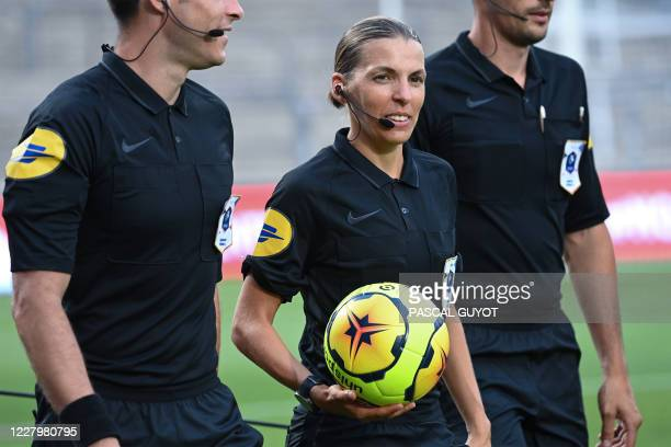 French referee Stephanie Frappart holds the ball before the French friendly football match between Nimes Olympique and Olympique de Marseille at the...