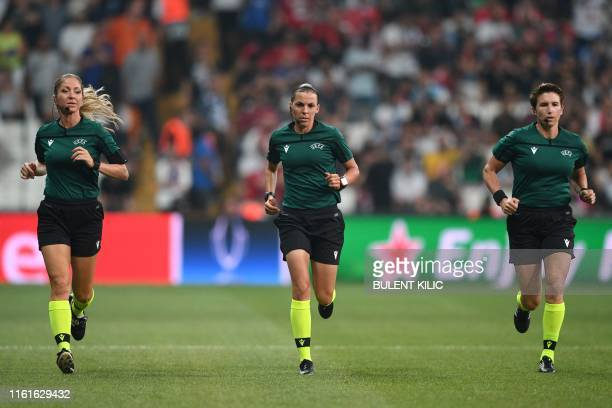French referee Stephanie Frappart runs across the pitch together with French assistant referee Manuela Nicolosi and Irish assitant referee Michelle...