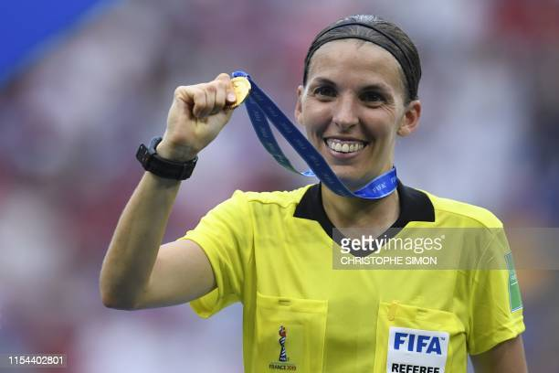 TOPSHOT French referee Stephanie Frappart shows her medal after the France 2019 Womens World Cup football final match between USA and the Netherlands...