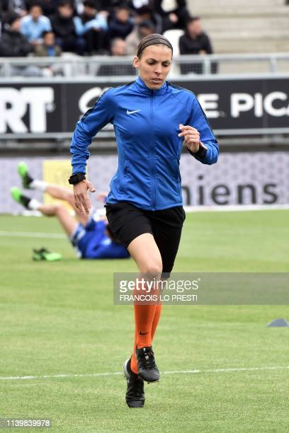 French referee Stephanie Frappart warmsup ahead of the French L1 football match between Amiens and Strasbourg on April 28 2019 at the Licorne Stadium...