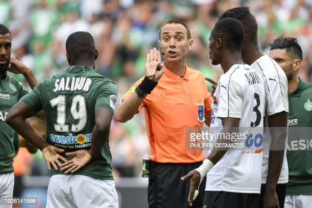 French referee Thomas Leonard talks with SaintEtienne and Amiens' players during the French L1 football match between AS SaintEtienne and Amiens SC...