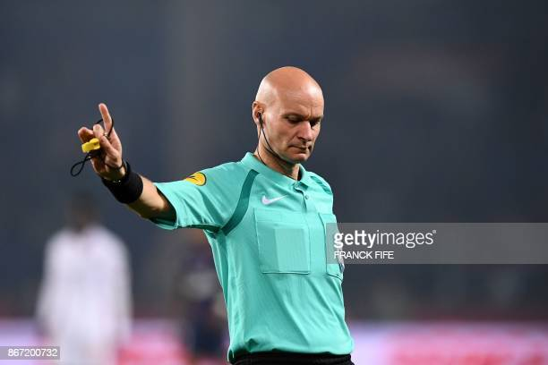 French referee Tony Chapron gestures during the French L1 football match between Paris SaintGermain and Nice on October 27 at the Parc des Princes...