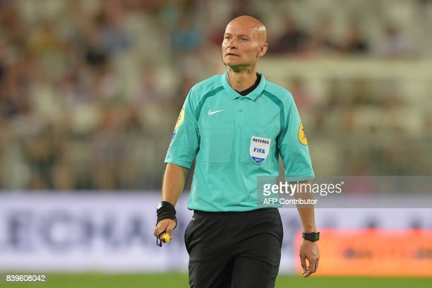 French referee Tony Chapron looks on during the French L1 football match between Bordeaux and Troyes on August 26 2017 at the Matmut Atlantique...