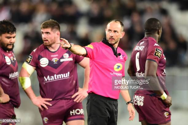 French referre Romain Poite gestures during the French Top 14 rugby union match between BordeauxBegles and Toulouse on March 3 2018 at the...