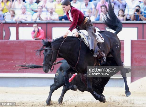 French rejoneadora Lea Vicens is hurled into the air by a bull during the San Isidro Feria at Las Ventas bullring in Madrid on June 10 2017 / AFP...
