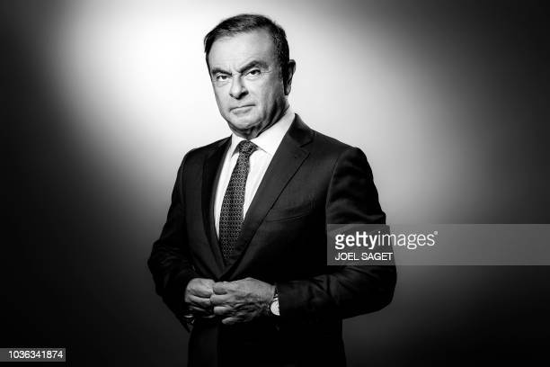 TOPSHOT French Renault group CEO and chairman of Japan's Nissan Motor CO Ltd and Mitsubishi Motors Corp Carlos Ghosn poses during a photo session at...
