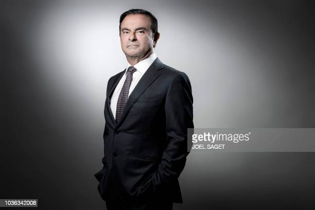 French Renault group CEO and chairman of Japan's Nissan Motor CO Ltd and Mitsubishi Motors Corp Carlos Ghosn poses during a photo session at the...
