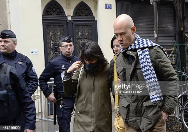 French reporter Laurent leger and French cartoonist Catherine Meurisse arrive to attend a meeting gathering editorial staff of French satirical...