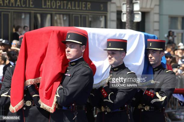 French Republican Guards carry the coffin of former French politician and Holocaust survivor Simone Veil as they walk on the rue Soufflot leading to...