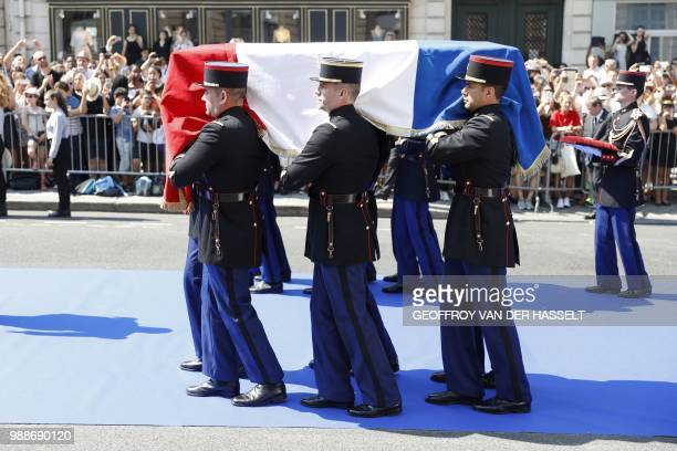 French Republican Guards carry the coffin of former French politician and Holocaust survivor Simone Veil and her husband Antoine Veil as they walk on...